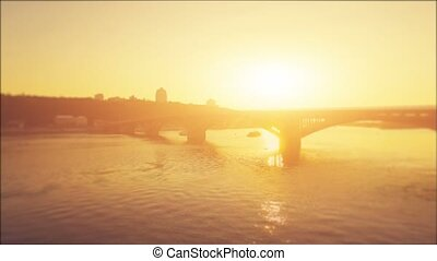 Aerial Drone Flight Footage: Metro Bridge through the Dnipro river in sunset soft light. Video blurred and processed in orange glow. Magestic landscape. Kiev, Ukraine, Europe. 4K resolution.