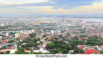 Metro Cebu at sunset - Panorama of Cebu city. Cebu is the...