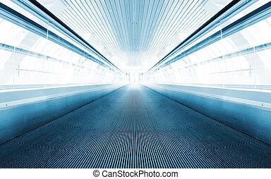 Metro escalator in glass corridor