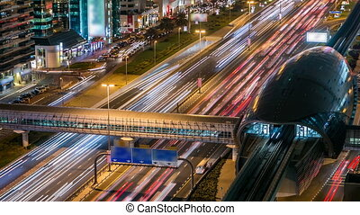 Metro Station with traffic on the highway timelapse in Dubai, UAE.