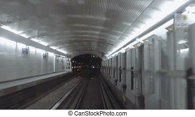 Metro subway station POV from moving train