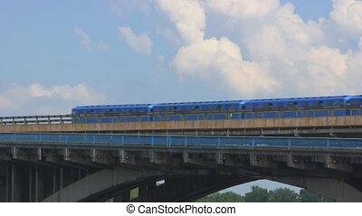 Metro train crosses the bridge across the Dnieper River in Kiev, Ukraine