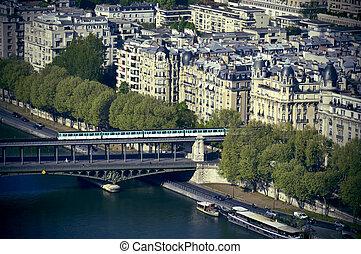 Metro train crossing Passy Bridge over the Seine River in Paris, France