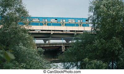metro train going over the bridge