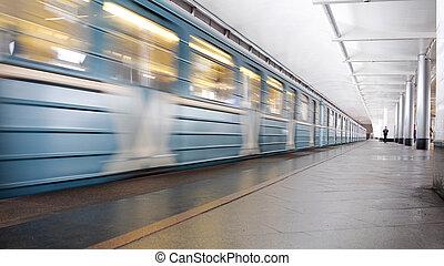 Metro train going throught the station