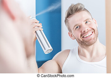 Metrosexual man using hair spray - Image of metrosexual man ...