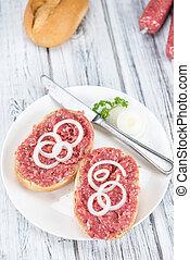Mett on a bun (German cuisine; selective focus)