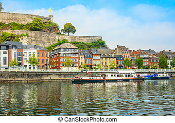 Meuse river with passenger boats and Citadel of Namur ...