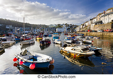 Small fishing boats in the historic harbour at Mevagissey Cornwall England UK Europe