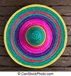 Mexican background - Mexican sombrero on old dark wood...