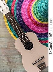 Mexican background with sombrero and guitar
