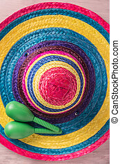 Mexican background with sombrero and maracas