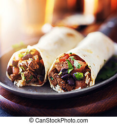 mexican beef steak burritos with black beans, rice, and...