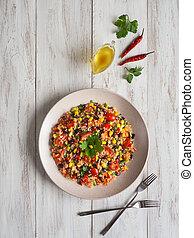Mexican black bean corn quinoa salad on the table. - Mexican...