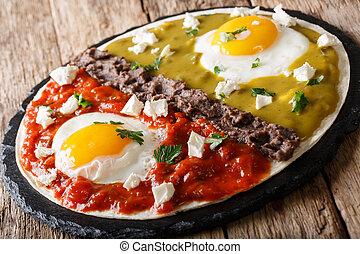 Mexican breakfast huevos divorciados of eggs with Frijoles...