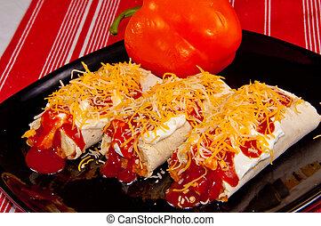 Mexican Burritos - Three Burritos covered in Sour Cream,...