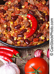 Mexican chili con carne close-up vertical view from above - ...