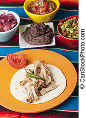 Mexican Cochinita pibil with tortilla