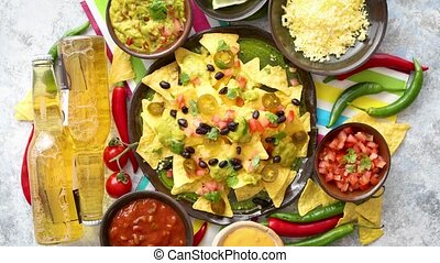 Mexican corn nacho spicy chips served with melted cheese, ...