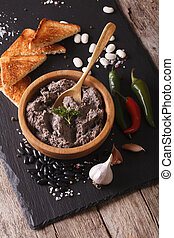 Mexican cuisine: Frijoles refritos with ingredients...