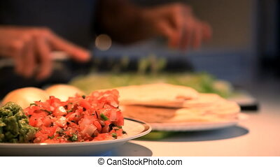 mexican dinner - Focus on salsa and guacamole with a person ...
