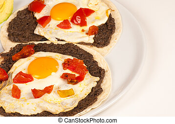 Mexican egg breakfast - Eggs on tortilla with refried...