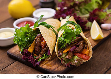 Mexican fajitas for beef and grilled vegetables (paprika,...