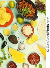 Mexican food concept: tortilla chips, guacamole, salsa,...