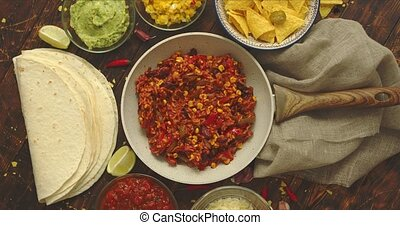 Mexican food concept. Vegetable burritos. Served on pan. Tortilla guacamole, salsa, chilli and beans
