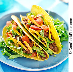 Mexican food - Hard shell tacos with beef, cheese, lettuce...
