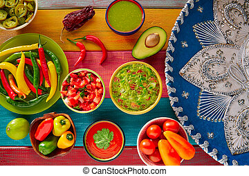 Mexican food mixed guacamole nachos chili sauce dipping...