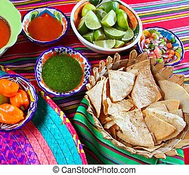 Mexican food varied chili sauces nachos lemon