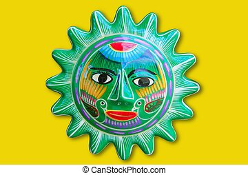 Mexican indian sun handcraft ceramic isolated in yellow...