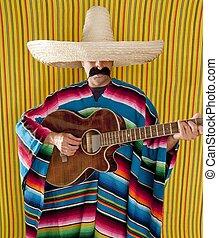 Mexican man serape poncho sombrero playing guitar