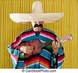 Mexican man serape poncho sombrero playing guitar