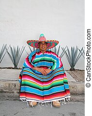 Mexican man sit sombrero serape and agave cactus