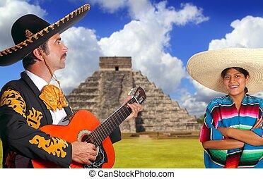 Mexican mariachi charro man and poncho Mexico girl Chichen...
