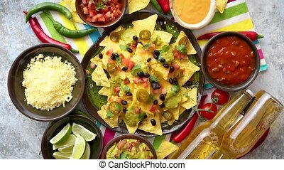 Mexican nachos tortilla chips with black bean, jalapeno, guacamole