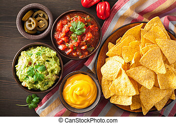 mexican nachos tortilla chips with guacamole, salsa and...