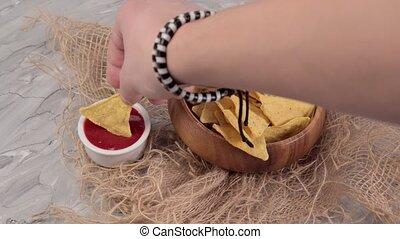 Mexican nachos with tomato ketchup sauce. Mexican food concept. selective focus