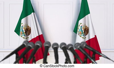 Mexican official press conference. Flags of Mexico and...
