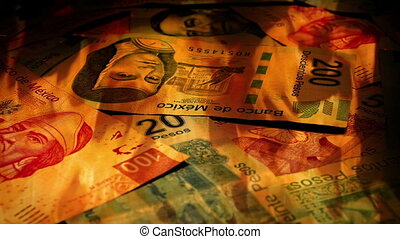 Mexican Peso Banknotes Rotating In Fire - Pile of mixed Peso...