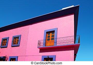 Mexican pink house facade  wooden doors