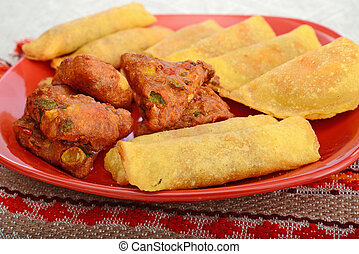 mexican snacks on red plate