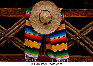 Mexican sombrero and scarf - Mexican ornaments hang on a ...