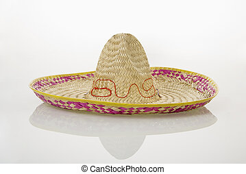 Mexican sombrero hat. - Mexican straw sombrero hat on white...