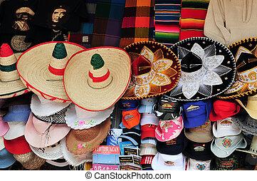 Mexican sombreros and cowboy hats