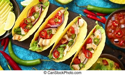 Mexican taco with chicken meat, jalapeno, fresh vegetables...