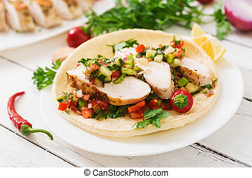 Mexican tacos with chicken and salsa.