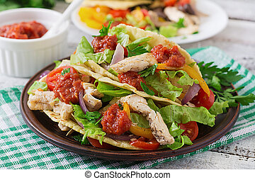 Mexican tacos with chicken, bell peppers, black beans and...
